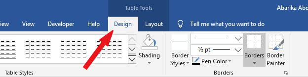 Go to Table Tools > Design tab - hide table lines in Word